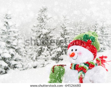 Smiling, happy snowman surrounded by winter landscape with falling snow - stock photo