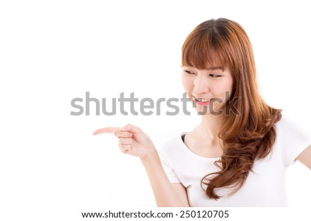 smiling, happy woman pointing sideway - stock photo