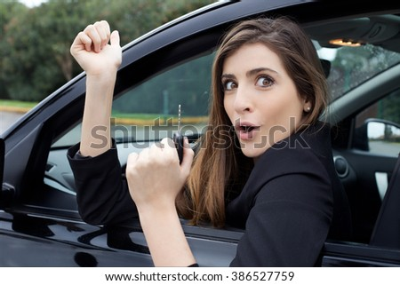smiling happy woman showing new car
