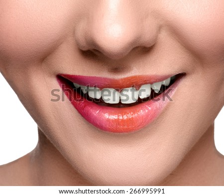 Smiling happy woman with colorful lips make up looking at the camera. Close up lips shot