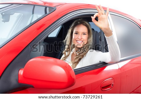 Smiling happy young woman  in the car - stock photo