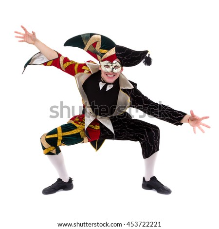 Smiling harlequin wearing a mask, isolated on white background in full length. - stock photo