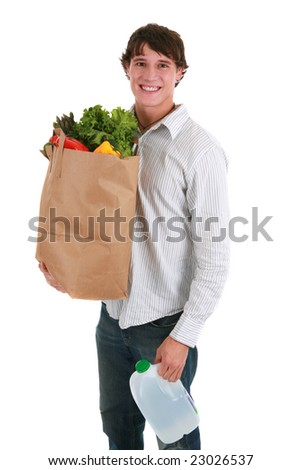 Smiling Healthy Looking Young Man Holding Groceries Paper and Water Bottle Bag Isolated - stock photo