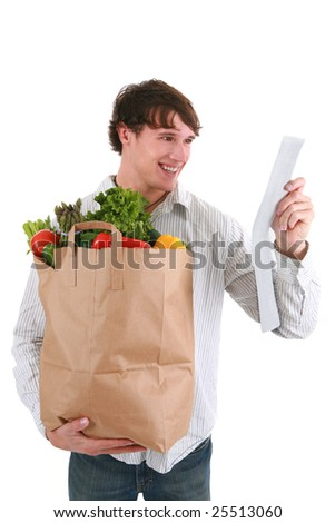 Smiling Healthy Looking Young Man Holding Groceries Paper Bag and Store Receipt Isolated - stock photo