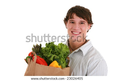 Smiling Healthy Looking Young Man Holding Groceries Paper Bag Isolated