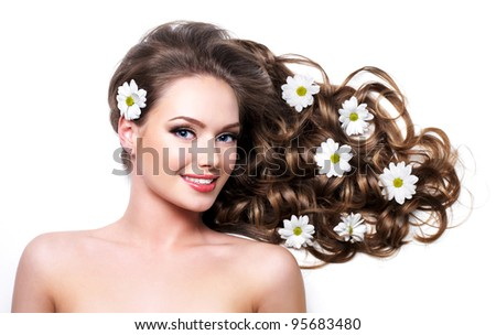 Smiling healthy woman with beautiful long hair  - white background - stock photo