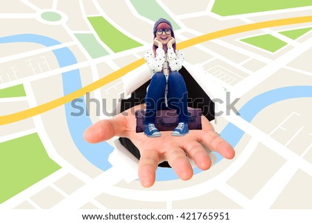 Smiling hipster woman sitting on suitcase against digital image of map - stock photo