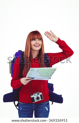 Smiling hipster woman with a travel bag with a map against white background