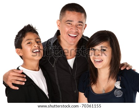 Smiling Hispanic father with happy children on white background - stock photo