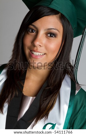 Smiling hispanic high school graduate