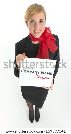 Smiling hostess holding a blank board ideal for inserting your own message - stock photo