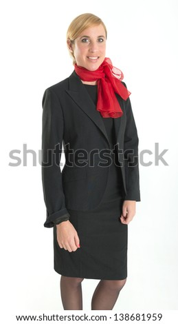 Smiling hostess with black uniform and red scarf - stock photo