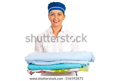 Smiling hotel maid holding stack of sheet to making bed isolated on white background - stock photo