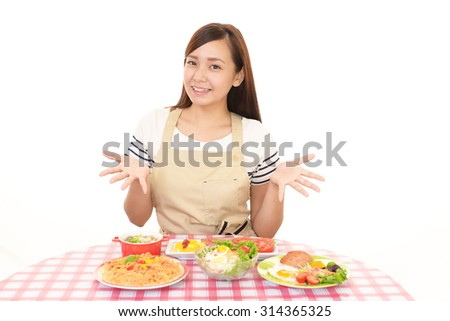 Smiling housewife with foods
