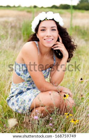 Smiling in a Field of flowers - stock photo
