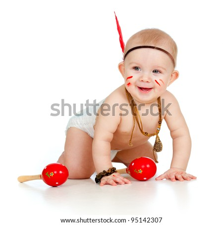 smiling indian boy baby feather playing stock photo