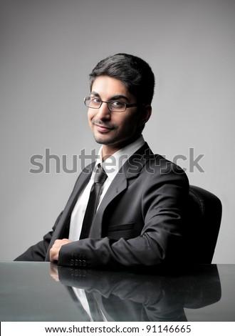 Smiling indian businessman - stock photo