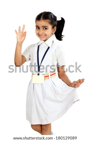 Smiling  Indian school girl showing okay sign hand isolated on white background - stock photo