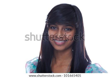 Smiling indian teen girl with brace on teeth - stock photo