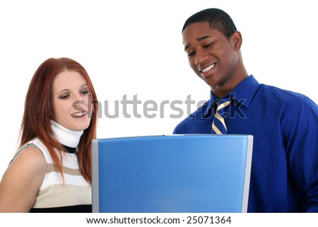 Smiling interracial couple with a laptop over white. - stock photo