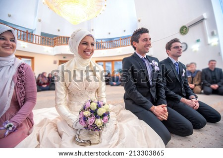 Smiling islamic bride and groom marrying at a mosque - stock photo