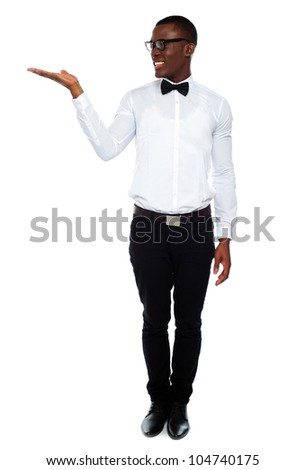 Smiling isolated man presenting copy space on white background - stock photo