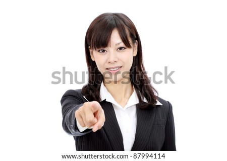 Smiling japanese business woman rise hand and pointing