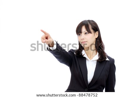 Smiling japanese business woman rise hand and pointing - stock photo