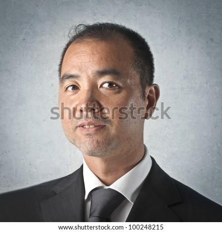 Smiling japanese businessman - stock photo