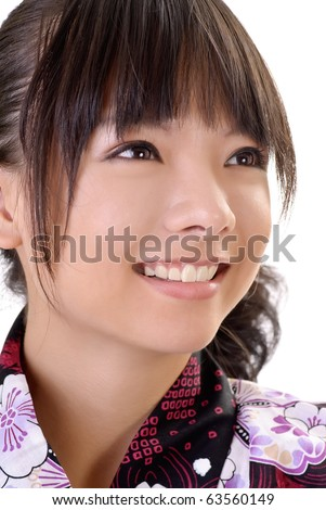 Smiling japanese girl face, closeup portrait of Asian woman in traditional clothes. - stock photo