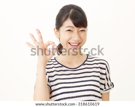 smiling Japanese woman OK gesture