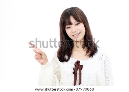Smiling japanese woman rise hand and pointing copy space