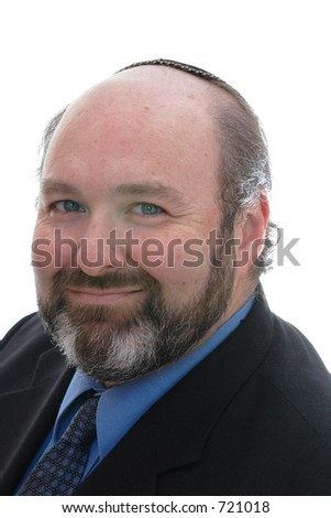 smiling jewish business man in yarmulke - stock photo