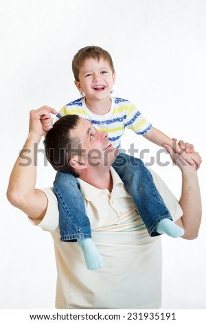 smiling kid boy riding dad's shoulders isolated on white - stock photo