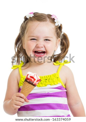 smiling kid girl eating ice cream isolated - stock photo