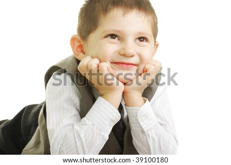Smiling kid looking up laying down against white background