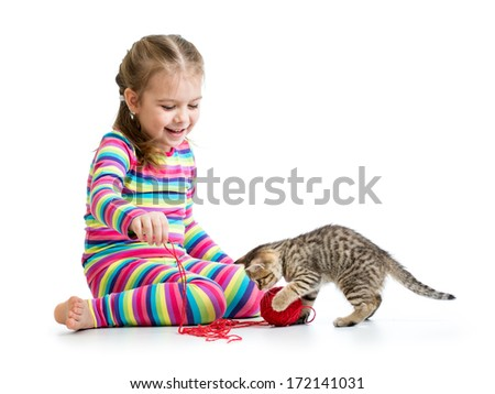 smiling kid playing with kitten - stock photo