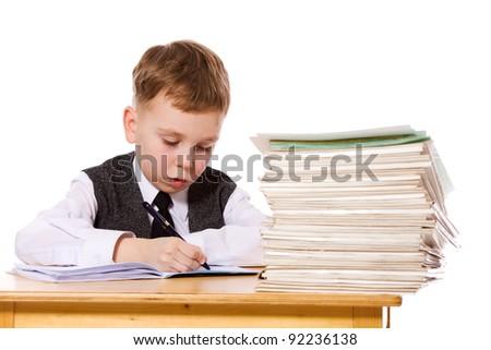 Smiling kid studying isolated on white - stock photo