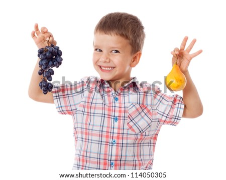 Smiling kid with grape and pear, isolated on white