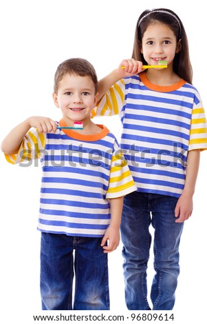 Smiling kids brushing teeth together, isolated on white - stock photo