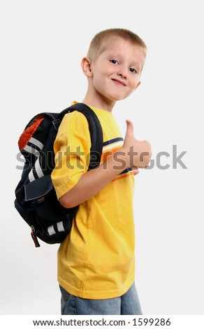 smiling kindergarten boy gives thumbs up - stock photo