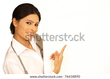 Smiling Lady doctor with ad space. Isolated on white background. - stock photo