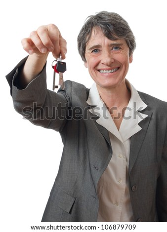 smiling lady holding keys on white background - stock photo