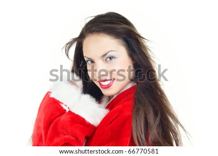 Smiling lady loving Christmas day in the red furry costume on a white background