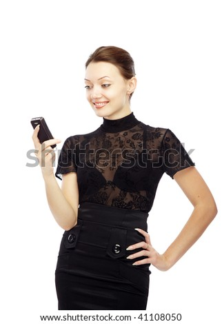Smiling lady reading SMS on her cell phone on a white background - stock photo