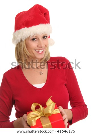 Smiling lady wearing a santa hat and holding a Christmas present. - stock photo