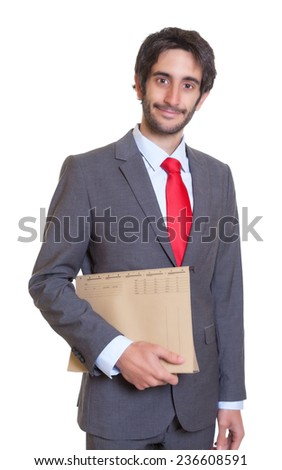Smiling latin businessman with file - stock photo