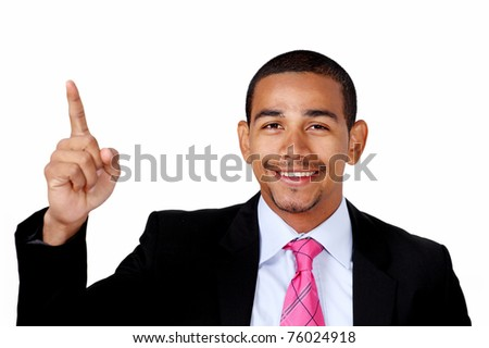 Smiling latino businessman pointing to copy space - stock photo