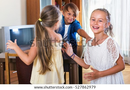 smiling laughing child chasing other kids to tag or touch them
