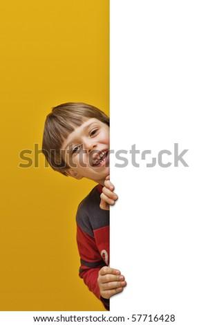 smiling litte boy holding white board - stock photo